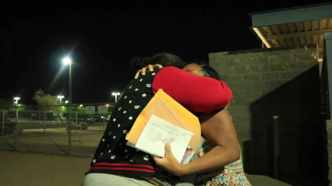 Theresa hugs her best friend moments after being released from jail.